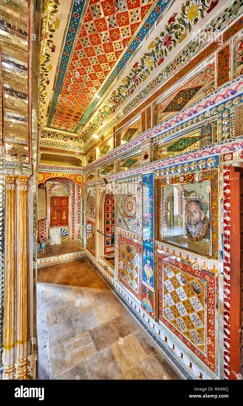 colorful mirrored room inside Kothari Patwa Haveli, Jaisalmer, Rajasthan, India - Stock Image