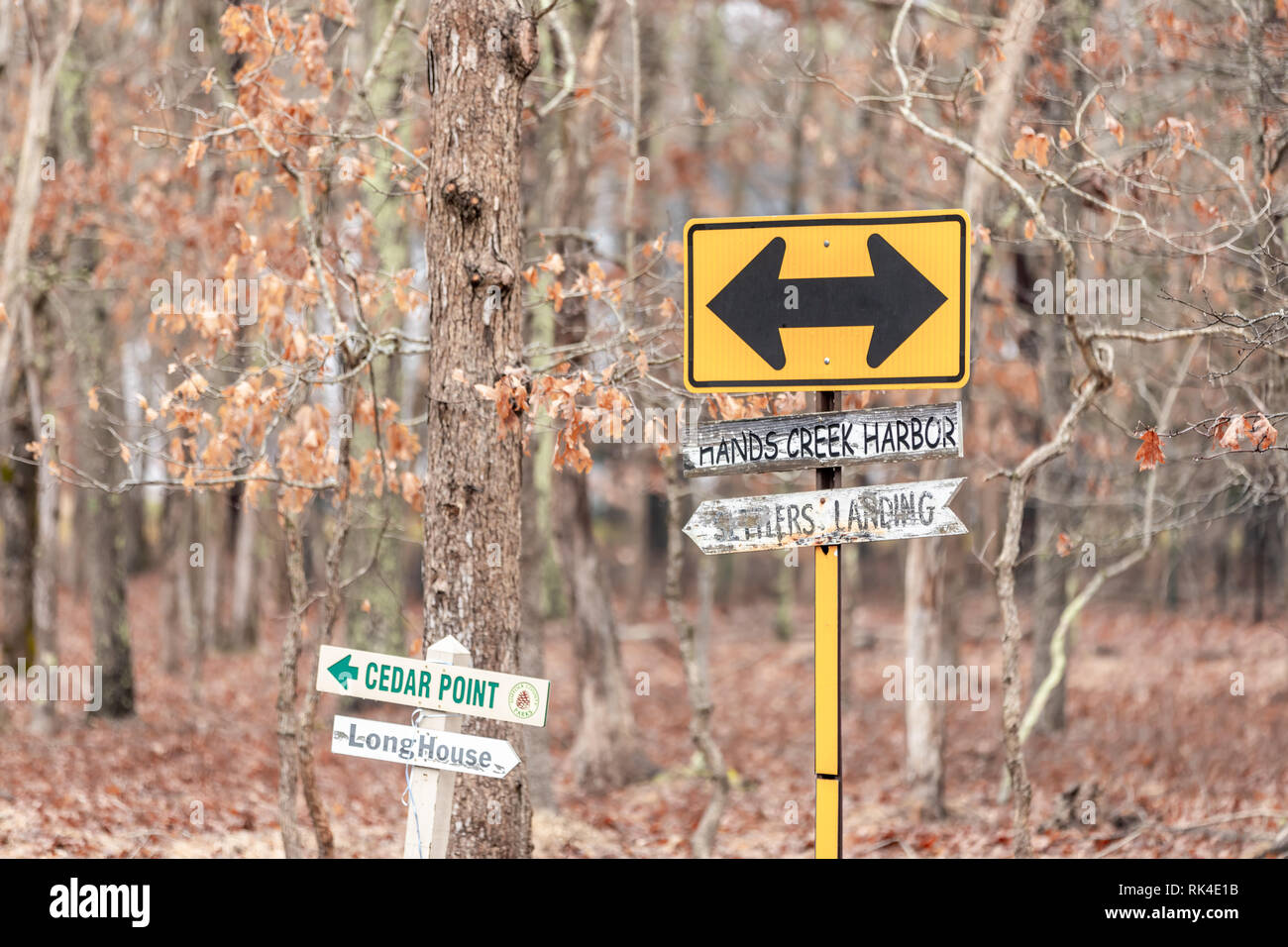 Various signs point to different locations in East Hampton, NY - Stock Image