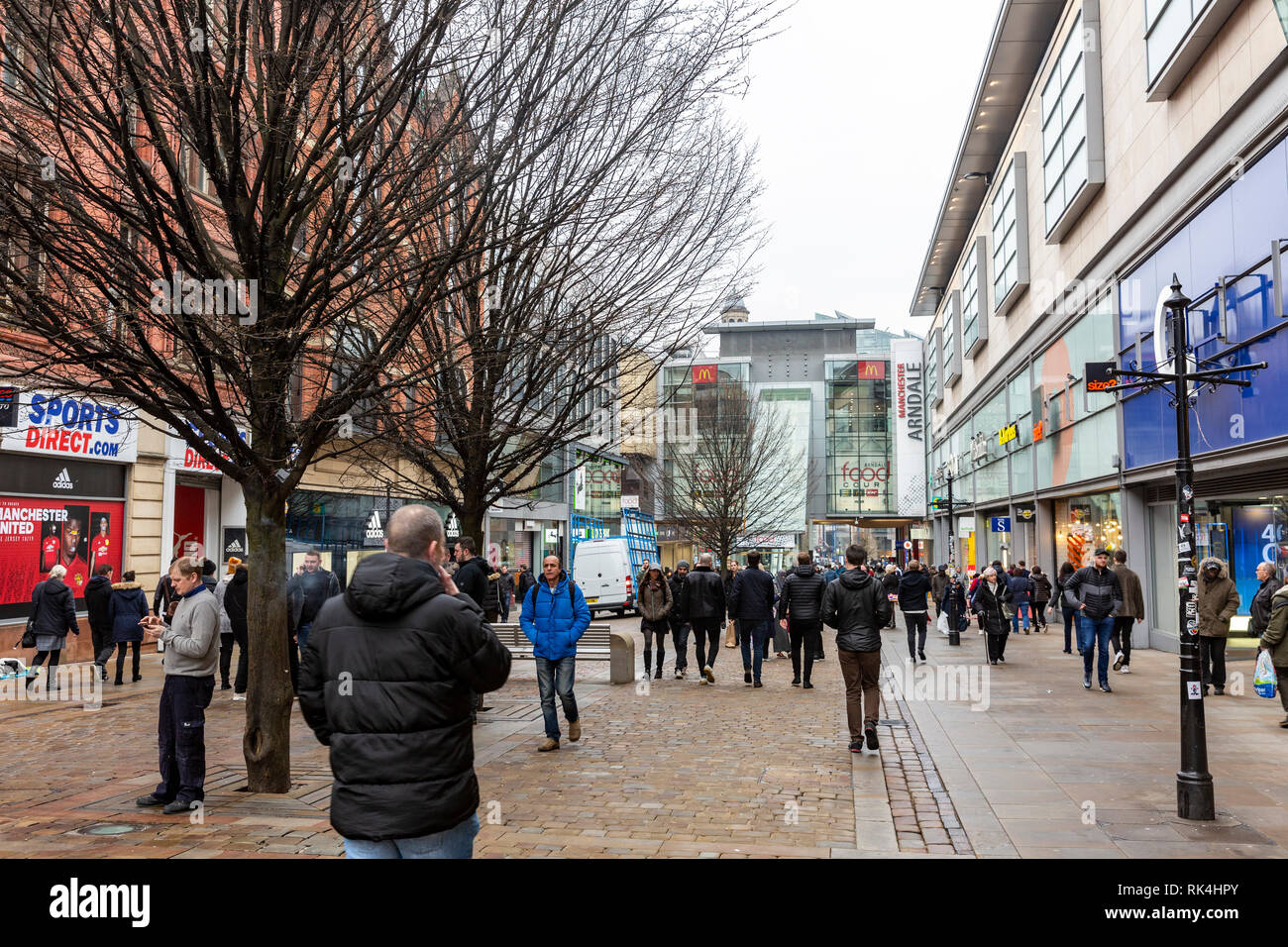 Shoppers in Manchester city centre on a winters day,Manchester,England - Stock Image