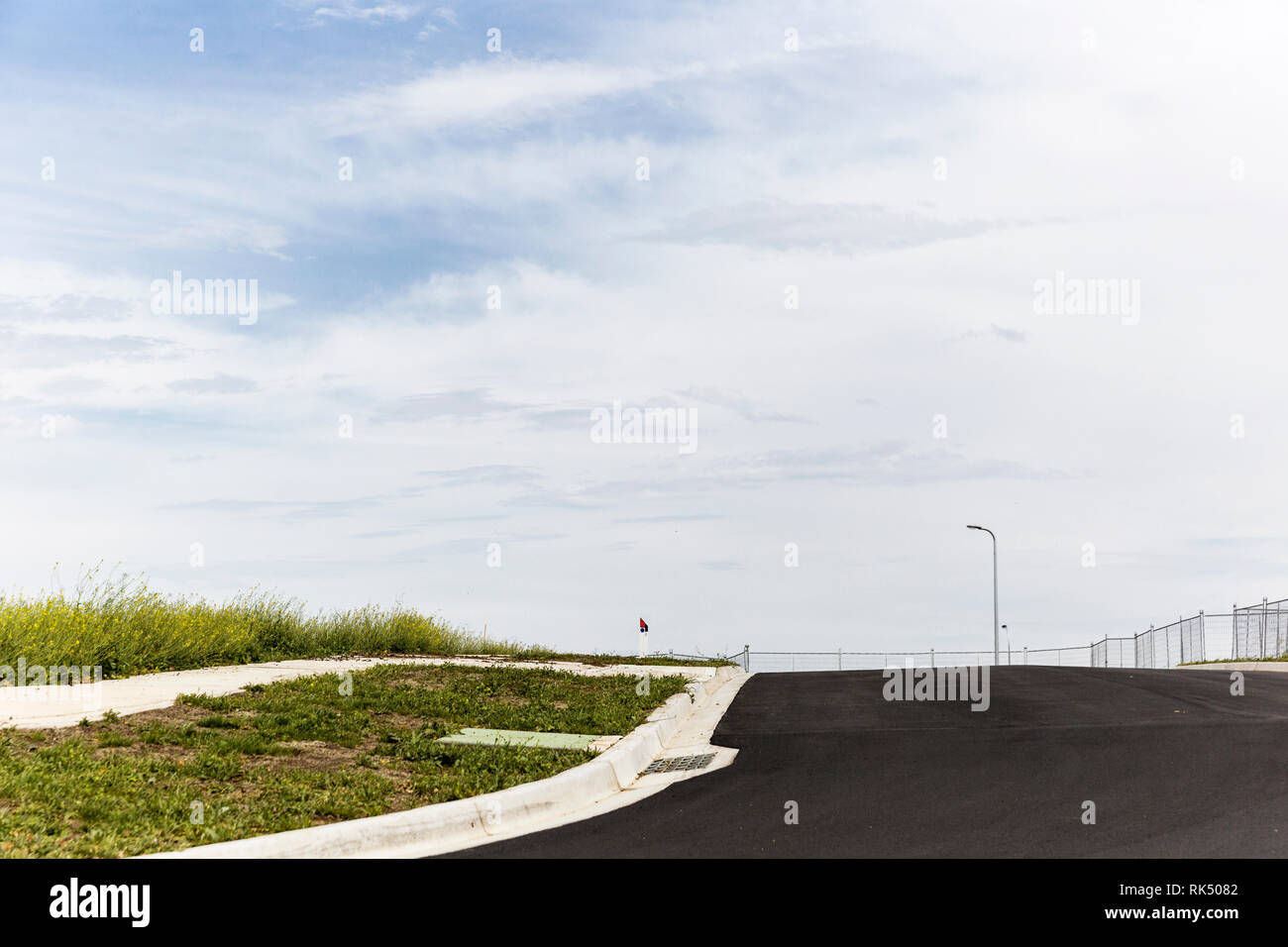 New developed area without any homes built on vacant land. - Stock Image