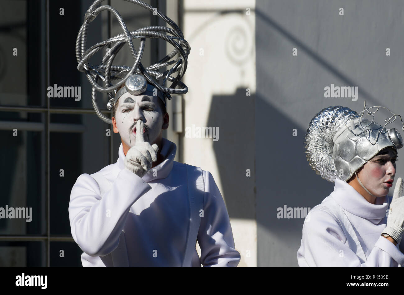 Saint Petersburg, Russia - August 4, 2018: Festival of street theatres. A man in a fantastic suit puts his index finger to to his lips and says Shh - Stock Image