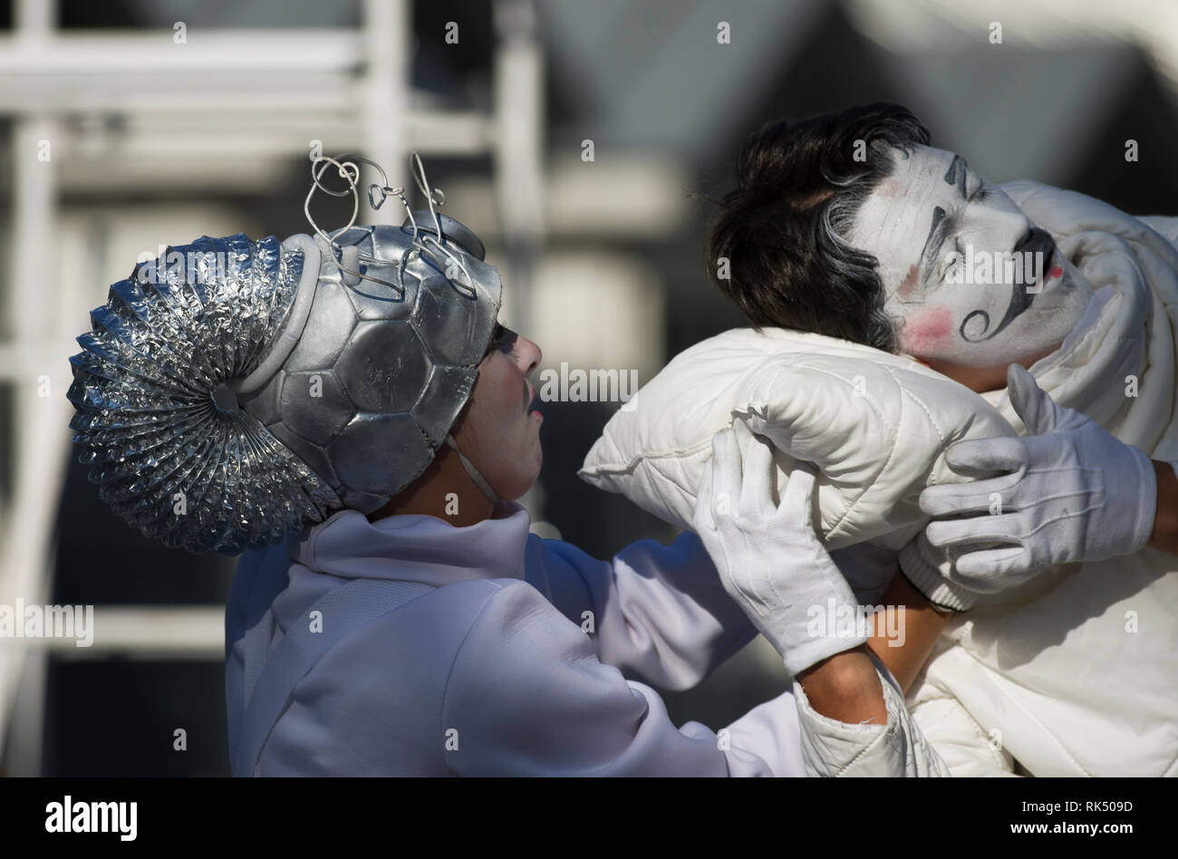 Saint Petersburg, Russia - August 4, 2018: International festival of street theatres `Elagin Park`. A man with a mustache is helped to sleep. - Stock Image