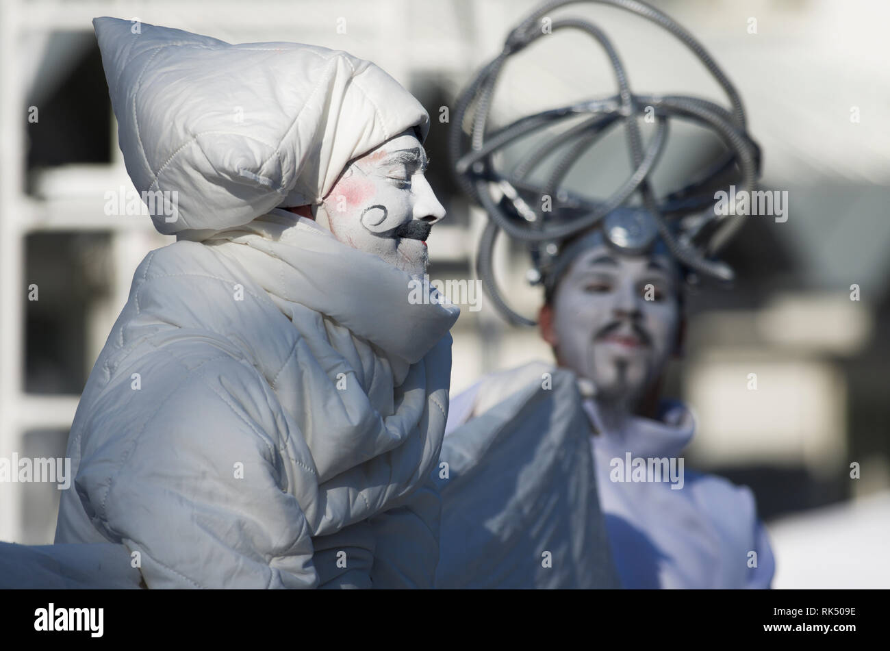Saint Petersburg, Russia - August 4, 2018: International festival of street theatres `Elagin Park`. A man with a mustache falls asleep satisfied. - Stock Image