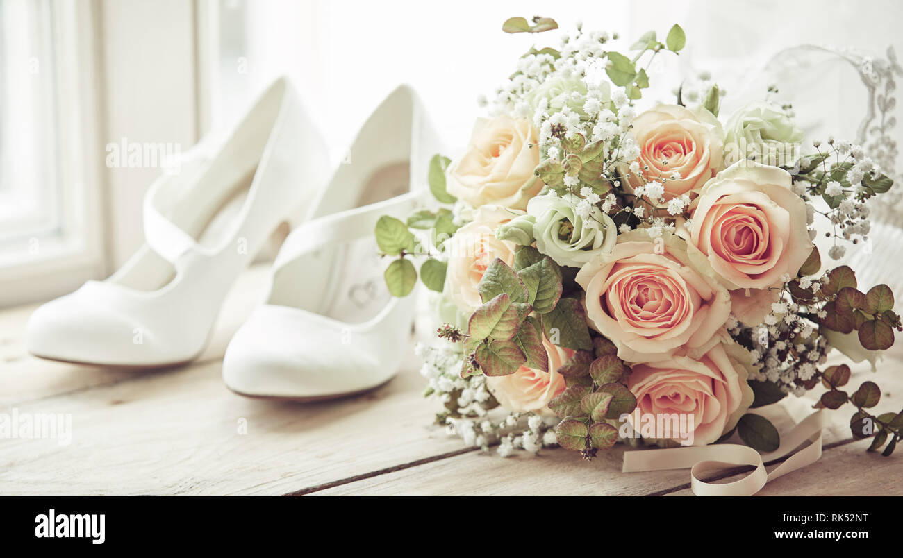 Brides White Shoes And Beautiful Wedding Bridal Bouquet Of Pink