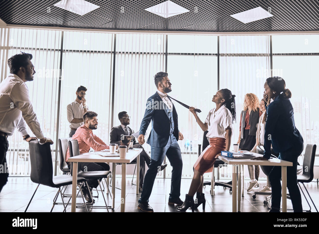 family onflict angry woman arguing with her male colleague. feeling, negative emotion during work, awesome beautiful american girl flirting with her c - Stock Image