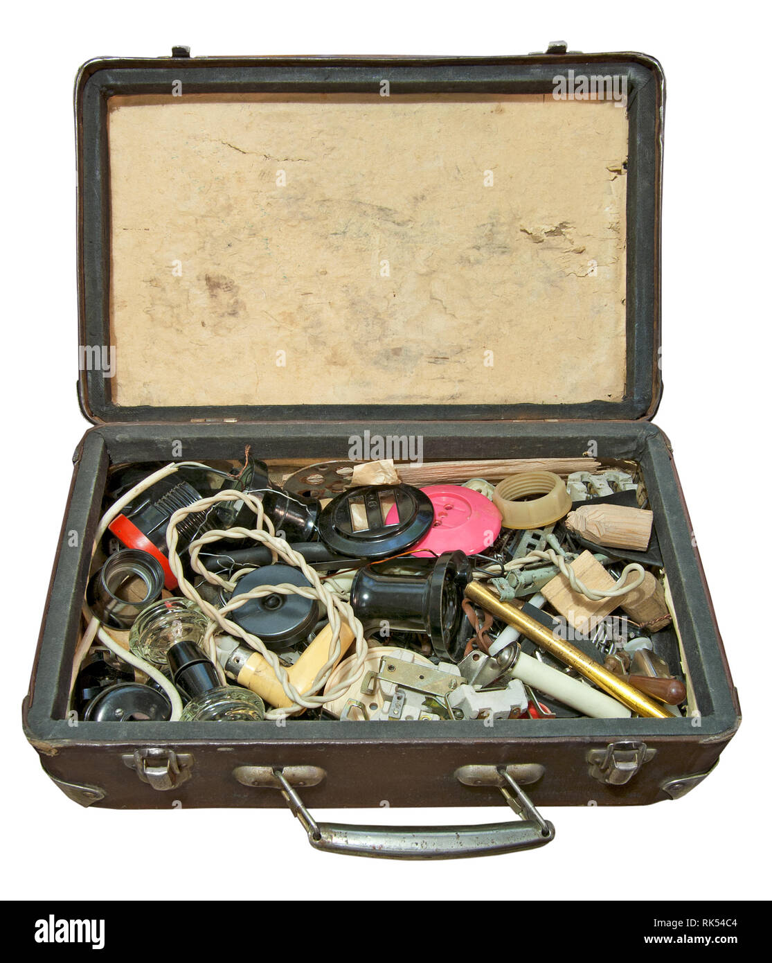 Dirty and dusty suitcase with old electrical accessories isolated on a white background. Close up image - Stock Image