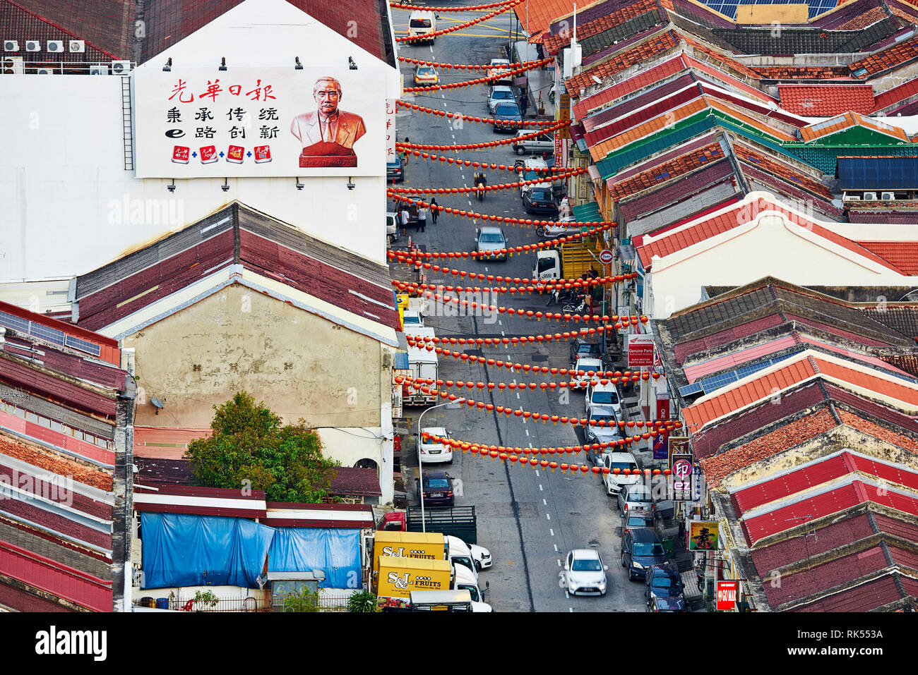 view of the roof and rows of shophouses in the old town from the top of the hotel Neo in George Town, Penang, Malaysia - Stock Image
