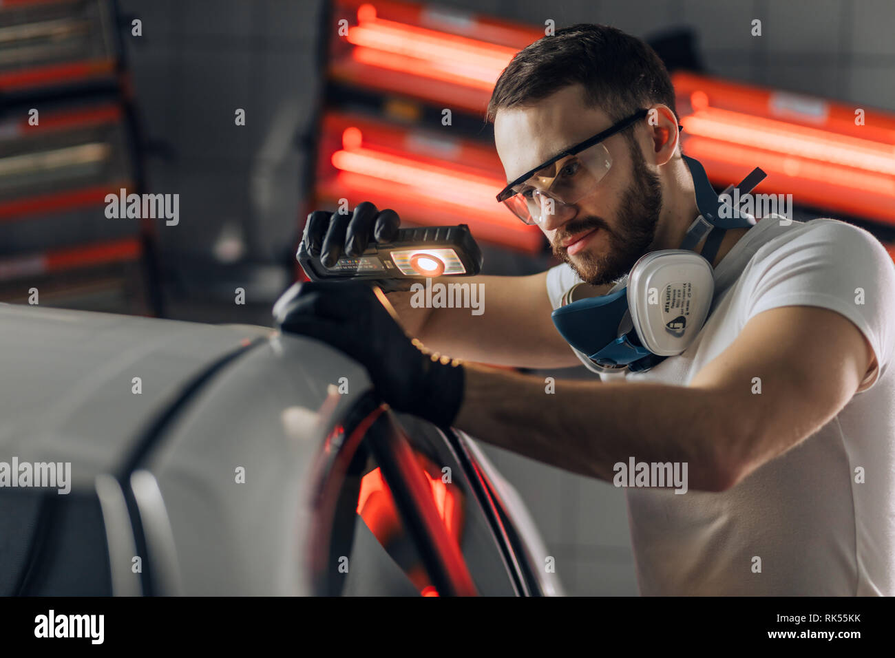 man working in the car repair shop. close up photo. Stock Photo