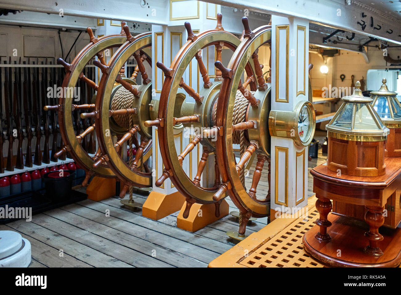 The below decks steering station on HMS Warrior in Porstmouth Dockyard with compass binacles - Stock Image