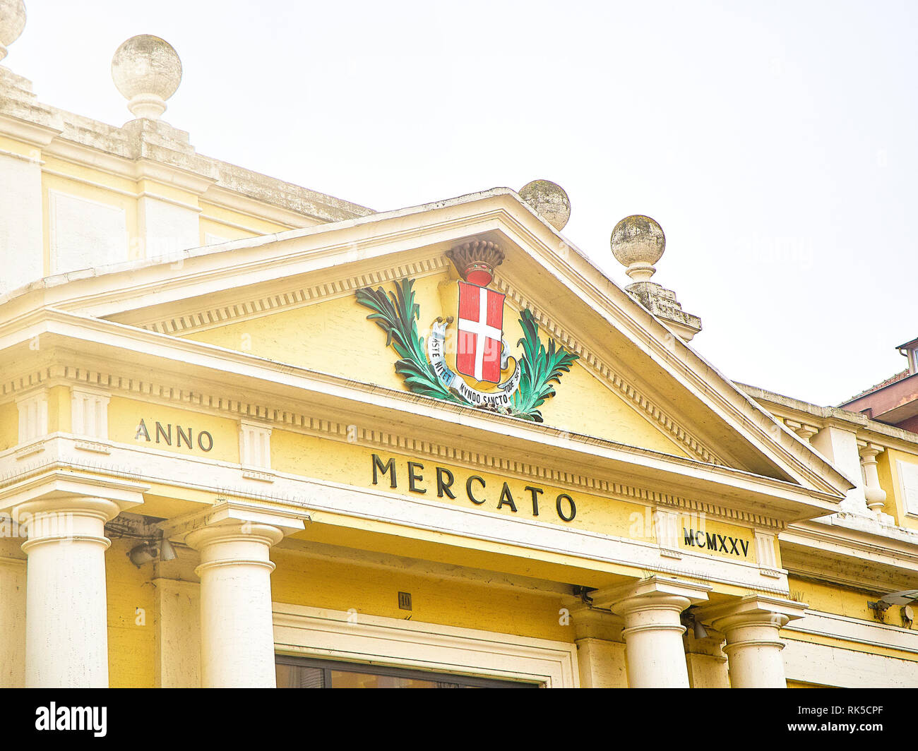 Main facade detail of The Mercato Coperto market. View from the Piazza della Liberta square. Asti, Piedmont, Italy. - Stock Image