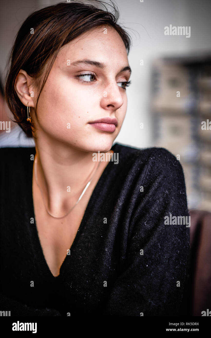 Young Generation Z woman lost in thought - Stock Image