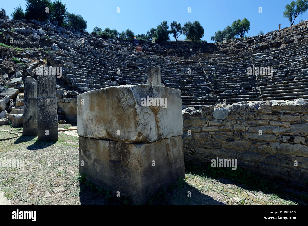 A carved Thyrsus, part of the decoration of the scene of the Hellenistic theatre, ancient Stratonicea, Eskihisar, Turkey. Built on a natural slope, th Stock Photo