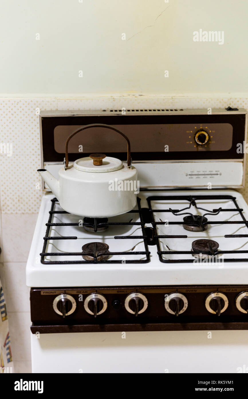 Retro style stove top with vintage kettle. Stock Photo