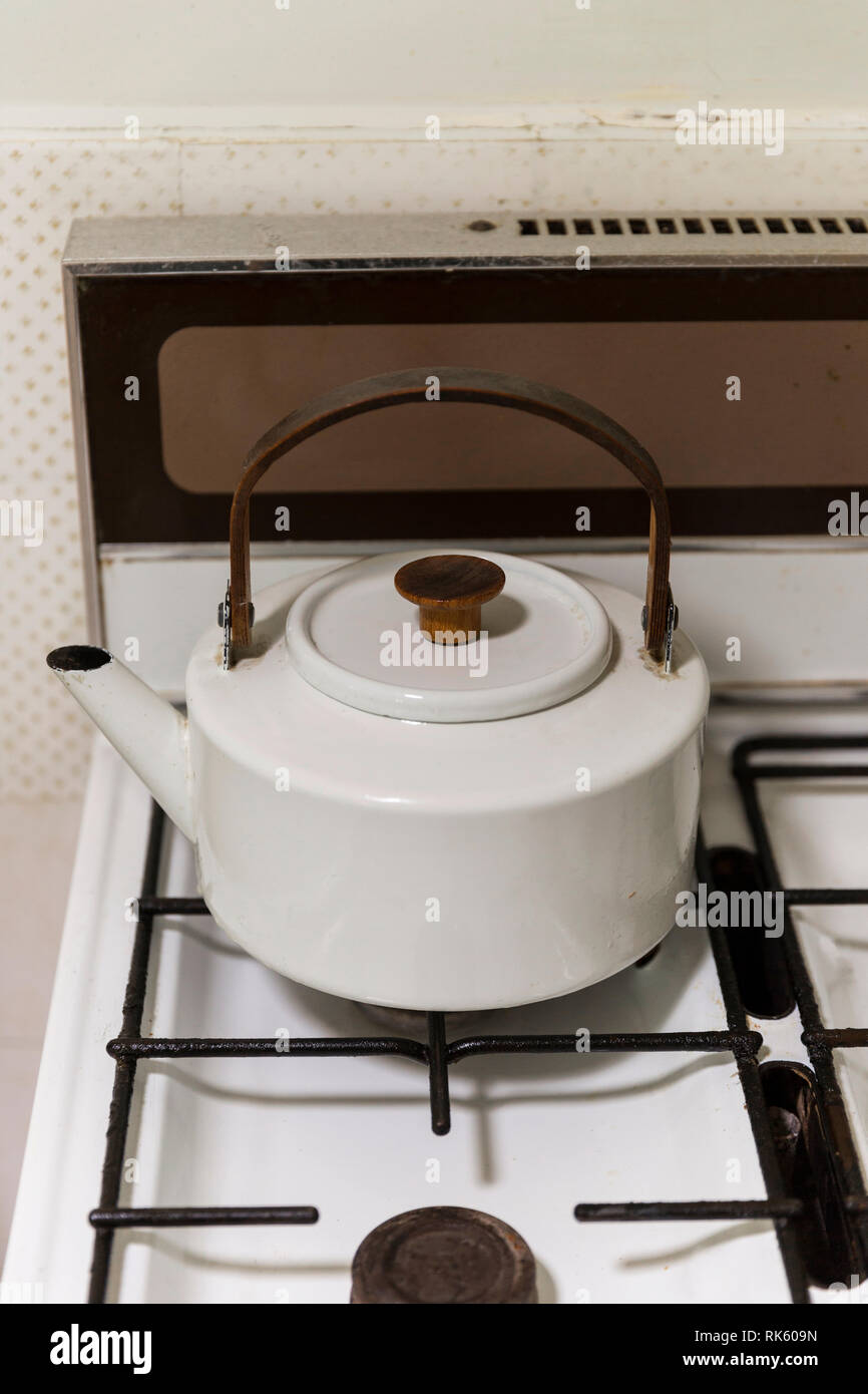 Retro style kettle on stove top. - Stock Image
