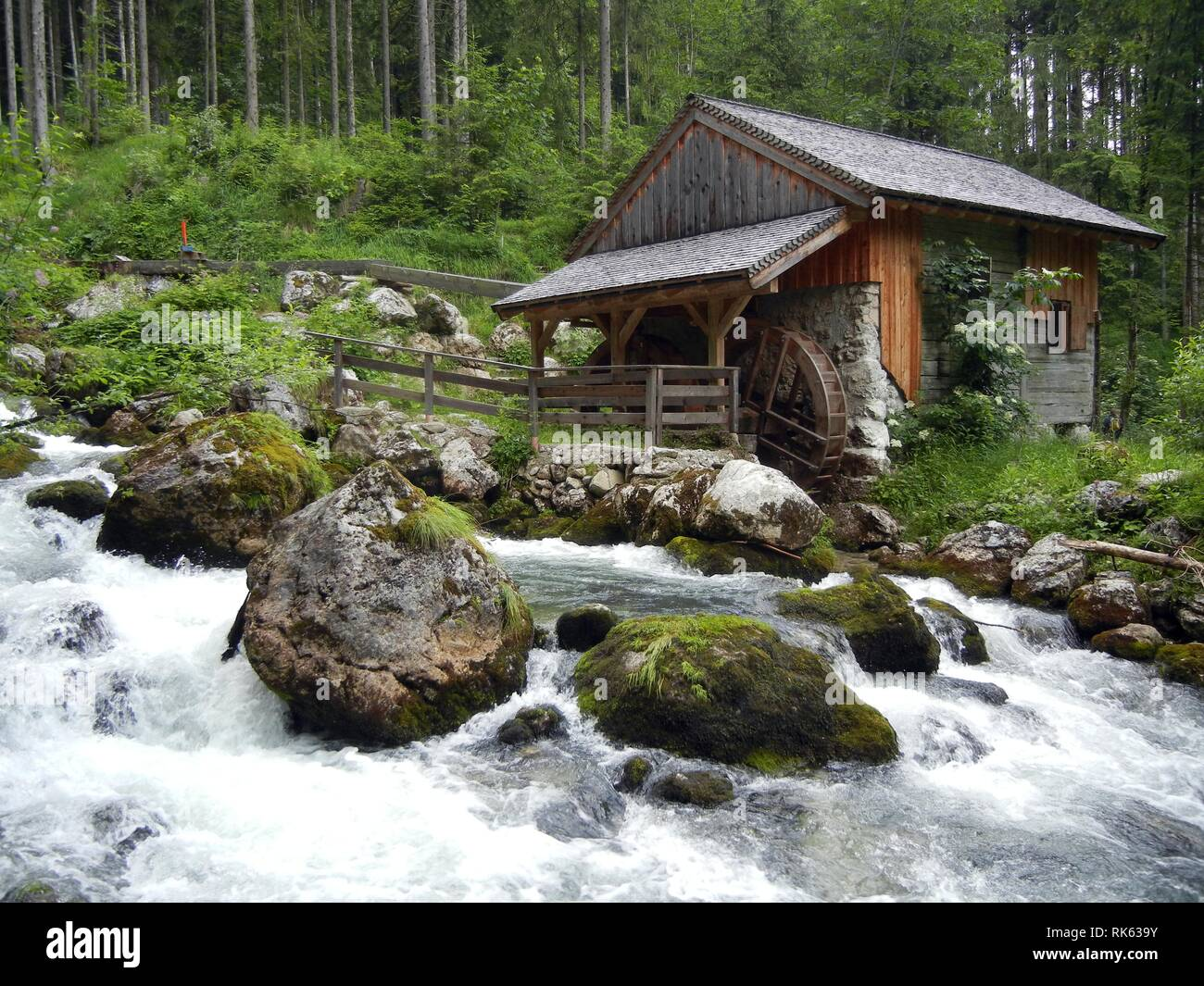 House with Watermill in Forest next to Hiking Trail at the Creek in Golling (Austria, Salzburg) - Stock Image