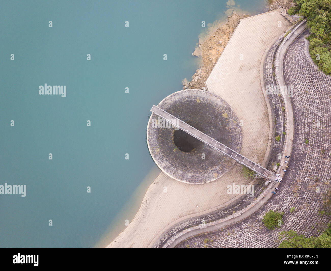 Shing Mun reservoir's overlow bellmouth seen by drone in Hong Kong - Stock Image