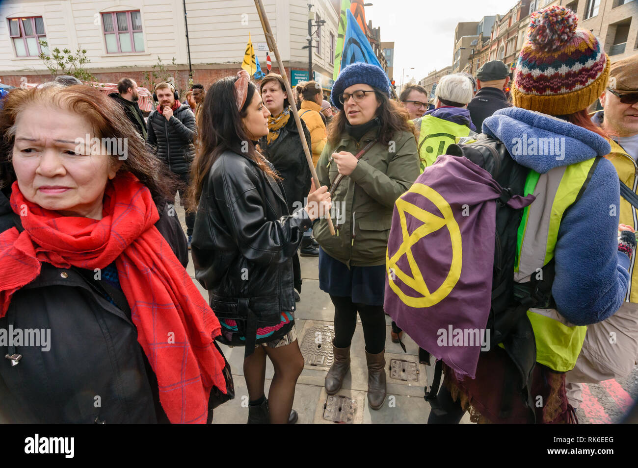 London, UK. 9th February 2019. Extinction Rebellion  which is in open Rebellion against the UK Government for its criminal inaction in the face of impending climate and ecological collapse hold a street party blocking the A10 Kingsland High St in Dalston for two hours with speeches, music and spoken word performances, t-shirt printing, face painting and free food, with dancing to a samba band which led them for a brief march up the road before returning to continue the protest in Gillett Square. Peter Marshall/Alamy Live News - Stock Image