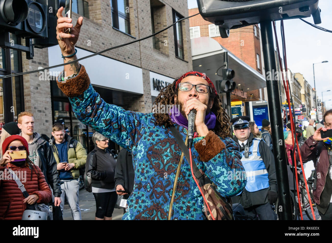 London, UK. 9th February 2019. A human beat-box performs at the Extinction Rebellionstreet party blocking the A10 Kingsland High St in Dalston for two housrs with speeches, music and spoken word performances, t-shirt printing, face painting and free food, with dancing to a samba band which led them for a brief march up the road before returning to continue the protest in Gillett Square.  XR is in open Rebellion against the UK Government for its criminal inaction in the face of impending climate and ecological collapse.  Peter Marshall/Alamy Live News - Stock Image