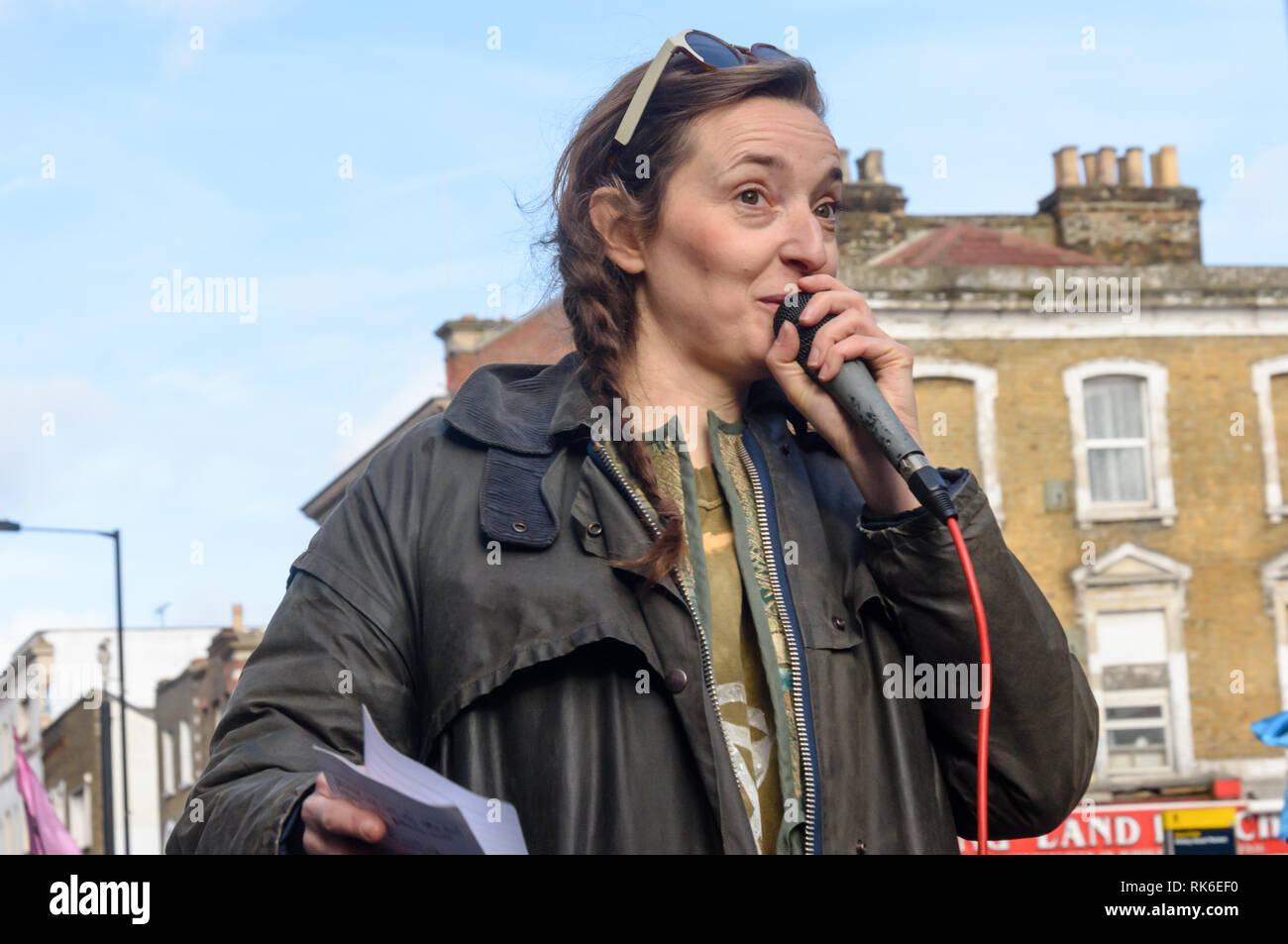 London, UK. 9th February 2019. A Hackney environmentalist speask at the Extinction Rebellionstreet party blocking the A10 Kingsland High St in Dalston for two housrs with speeches, music and spoken word performances, t-shirt printing, face painting and free food, with dancing to a samba band which led them for a brief march up the road before returning to continue the protest in Gillett Square.  XR is in open Rebellion against the UK Government for its criminal inaction in the face of impending climate and ecological collapse.  Peter Marshall/Alamy Live News - Stock Image