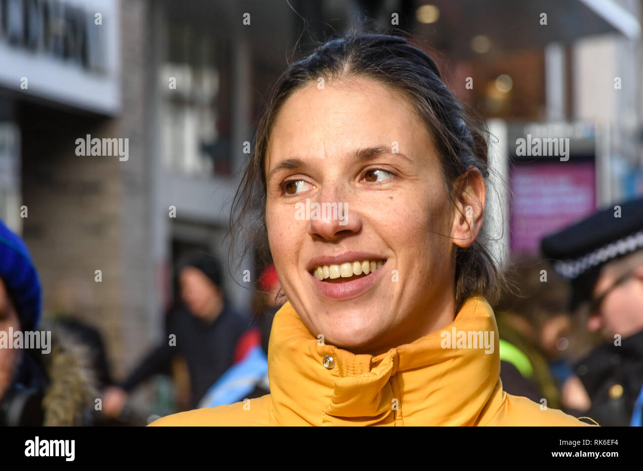London, UK. 9th February 2019. woman from Plastic Free Hackney waits to speak at the Extinction Rebellionstreet party blocking the A10 Kingsland High St in Dalston for two housrs with speeches, music and spoken word performances, t-shirt printing, face painting and free food, with dancing to a samba band which led them for a brief march up the road before returning to continue the protest in Gillett Square.  XR is in open Rebellion against the UK Government for its criminal inaction in the face of impending climate and ecological collapse.  Peter Marshall/Alamy Live News - Stock Image