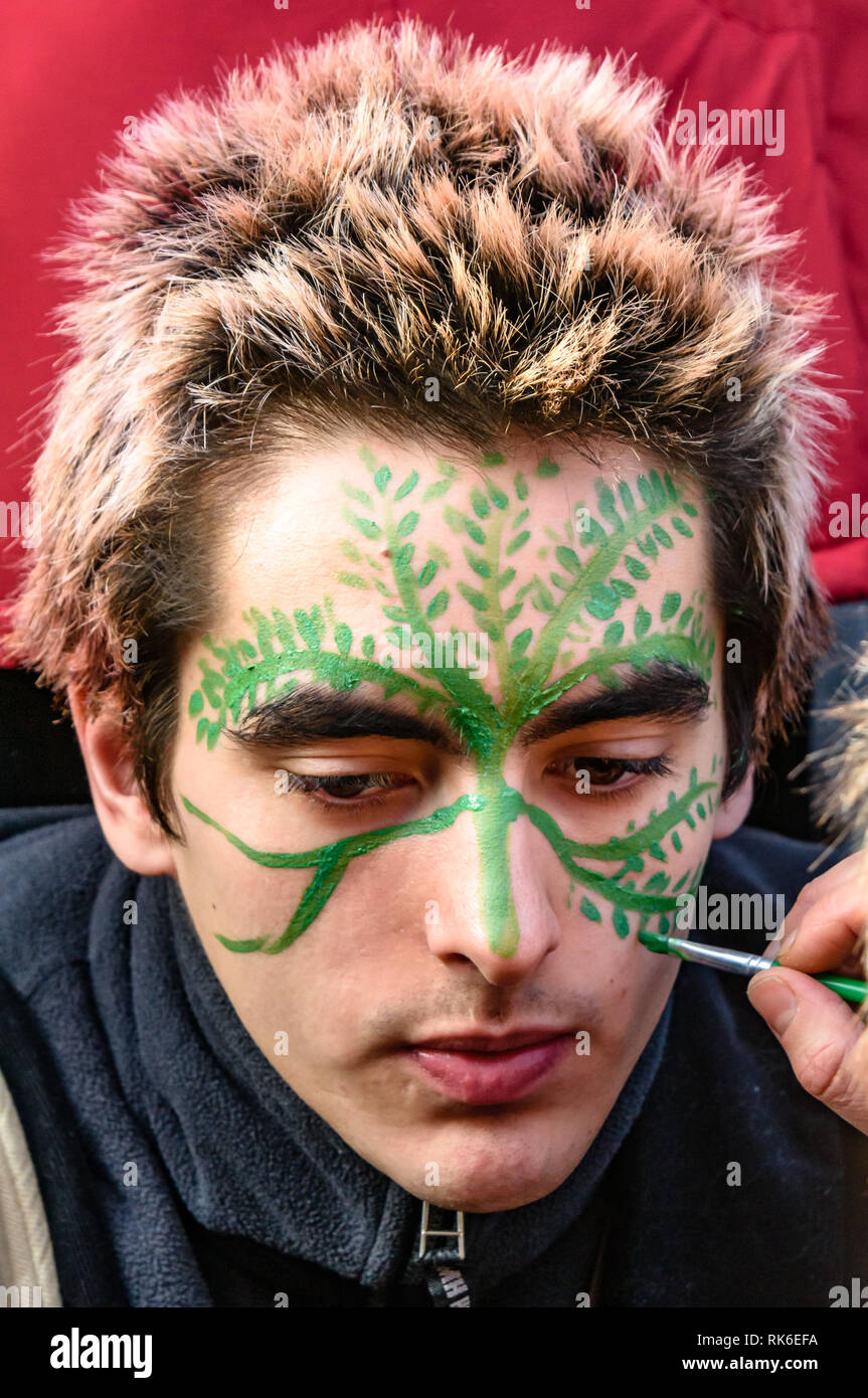 London, UK. 9th February 2019. A man has his face painted at the Extinction Rebellionstreet party blocking the A10 Kingsland High St in Dalston for two housrs with speeches, music and spoken word performances, t-shirt printing, face painting and free food, with dancing to a samba band which led them for a brief march up the road before returning to continue the protest in Gillett Square.  XR is in open Rebellion against the UK Government for its criminal inaction in the face of impending climate and ecological collapse.  Peter Marshall/Alamy Live News - Stock Image