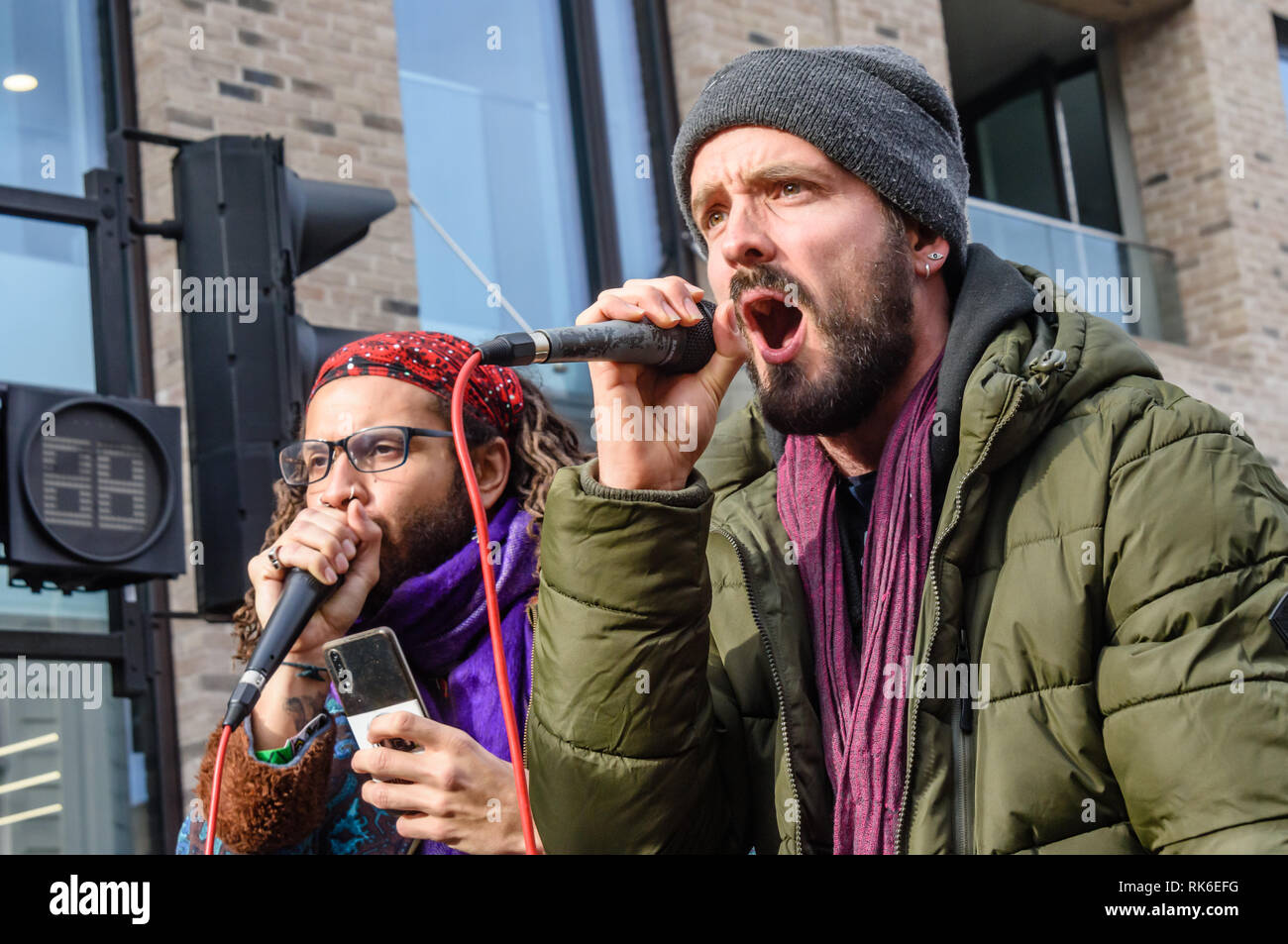 London, UK. 9th February 2019. Dizraeli performs with a human beat-box at the Extinction Rebellion street party blocking the A10 Kingsland High St in Dalston for two hours with speeches, music and spoken word performances, t-shirt printing, face painting and free food, with dancing to a samba band which led them for a brief march up the road before returning to continue the protest in Gillett Square.  Xr has declared open rebellion against the UK Government for its criminal inaction in the face of impending climate and ecological collapse.  Peter Marshall/Alamy Live News - Stock Image