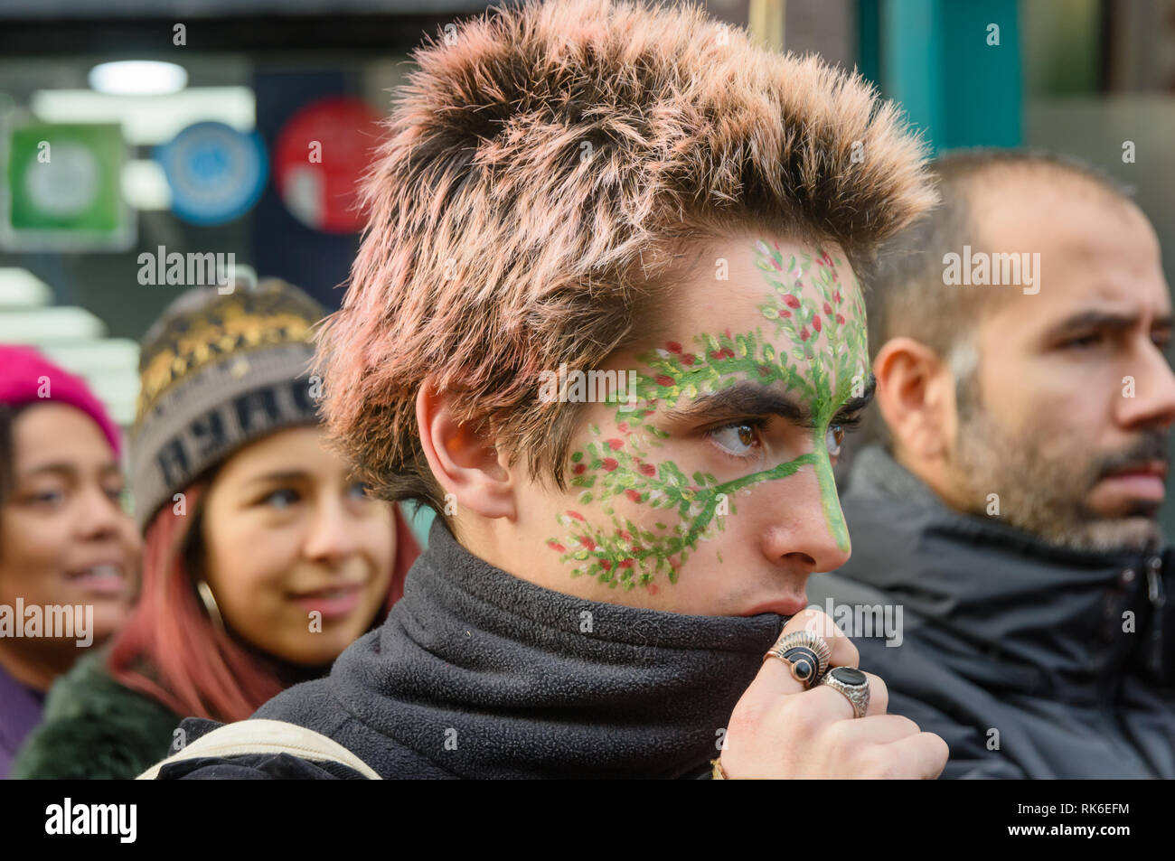 London, UK. 9th February 2019. A man with a painted face at the Extinction Rebellionstreet party blocking the A10 Kingsland High St in Dalston for two housrs with speeches, music and spoken word performances, t-shirt printing, face painting and free food, with dancing to a samba band which led them for a brief march up the road before returning to continue the protest in Gillett Square.  XR is in open Rebellion against the UK Government for its criminal inaction in the face of impending climate and ecological collapse.  Peter Marshall/Alamy Live News - Stock Image