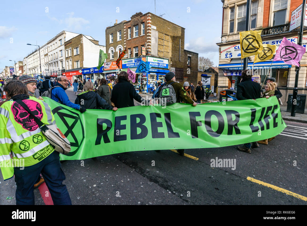 London, UK. 9th February 2019. Extinction Rebellion  which is in open Rebellion against the UK Government for its criminal inaction in the face of impending climate and ecological collapse march up the A10 Kingsland High St in Dalston at the end of their two hour street party blocking the raod behind the samba band before returning to continue the protest in Gillett Square. Peter Marshall/Alamy Live News - Stock Image