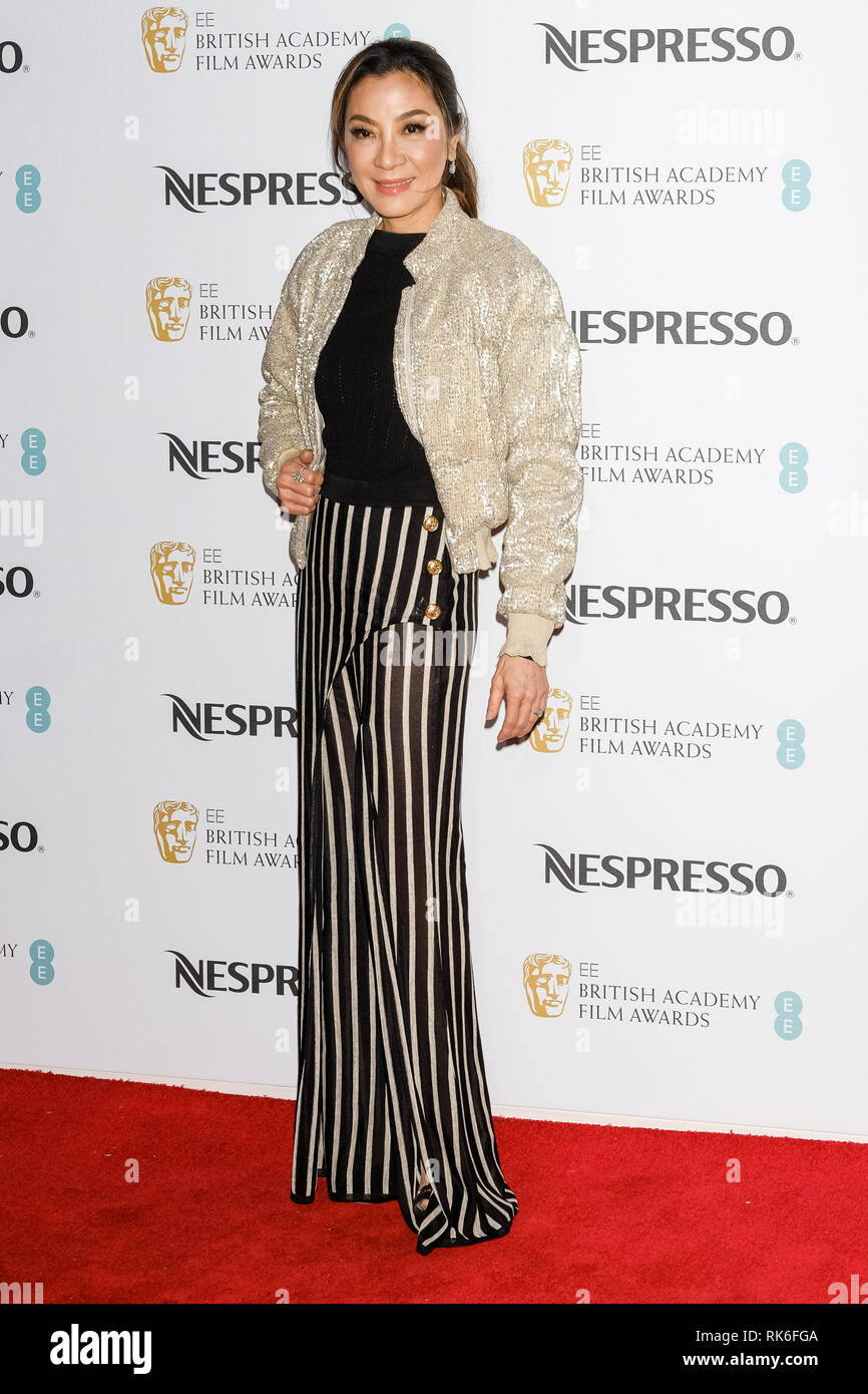 London, UK. Michelle Yeoh poses at the BAFTA Nespresso Nominees Party on Saturday 9 February 2019 at Kensington Palace, London. . Picture by Julie Edwards. Credit: Julie Edwards/Alamy Live News - Stock Image