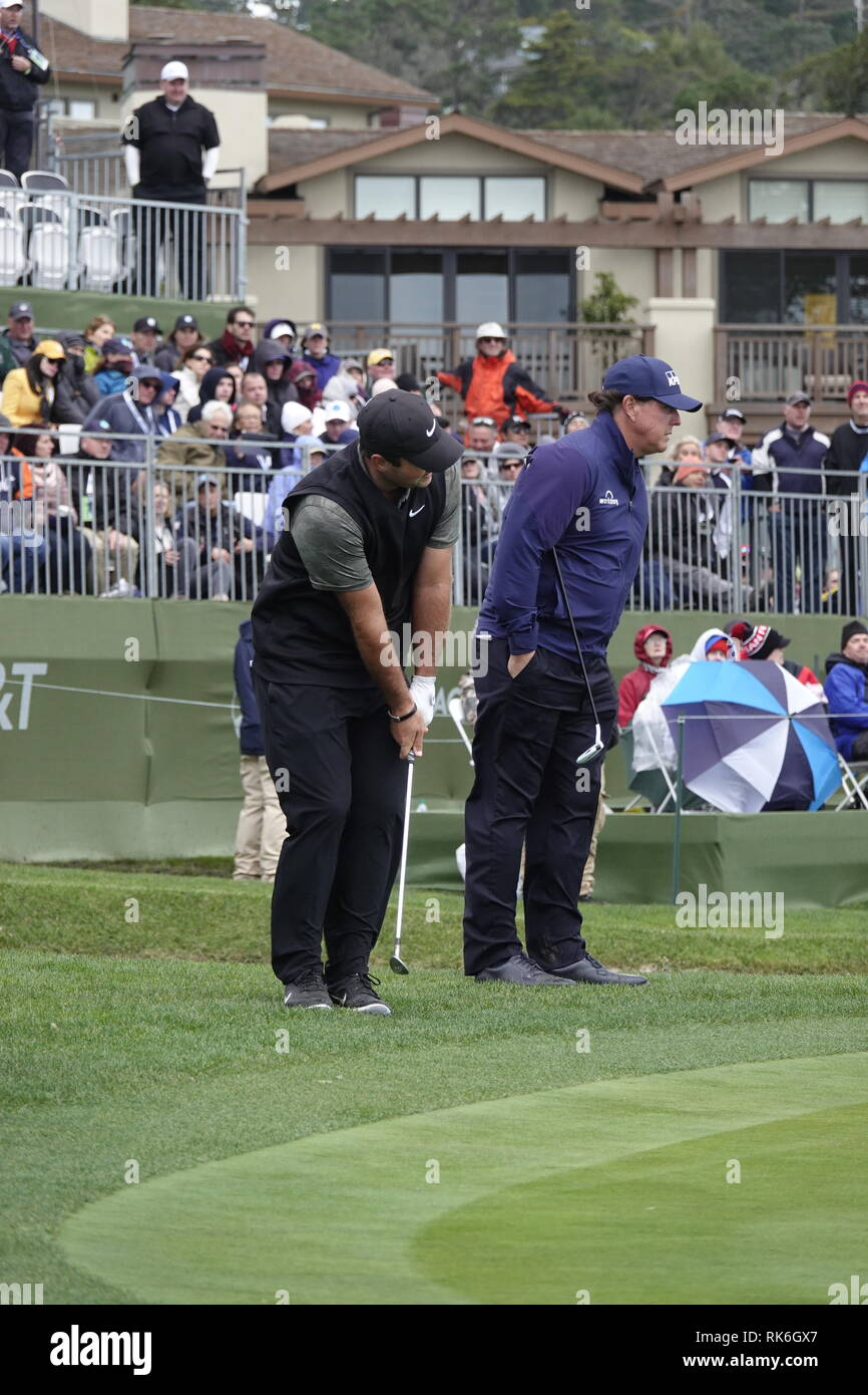 9th February, 2019  Pebble Beach Golf Links, CA, USA  Phil Mickleson watches Patrick Reed's chip on the 18th ball during the third round at Pebble Beach Golf Course during the AT&T Pro-Am Credit: Motofoto/Alamy Live News - Stock Image