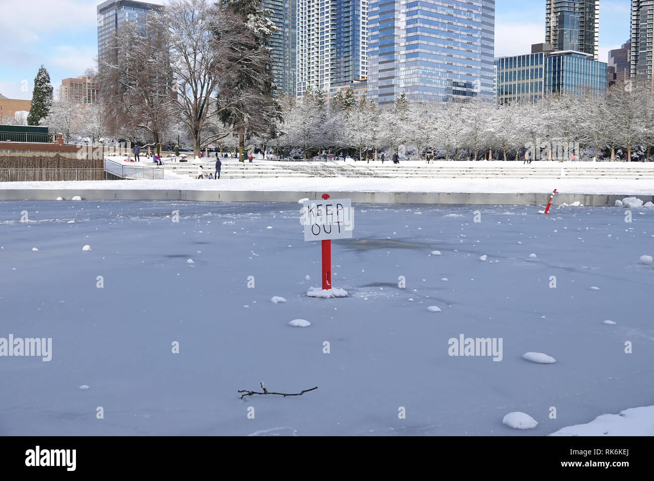 Bellevue, WA, USA. 9th Feb, 2019. The Downtown Park lake is frozen and emergency Keep Out signs are posted Stock Photo