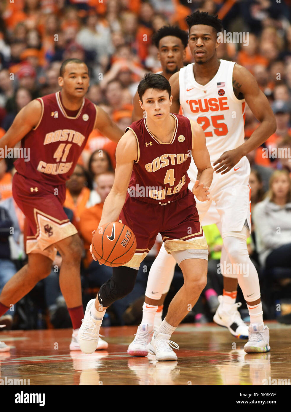 85bb037672d Boston College guard Chris Herren Jr. (4) takes the ball down court during  the second half of play. The Syracuse Orange defeated the Boston College  Eagles ...