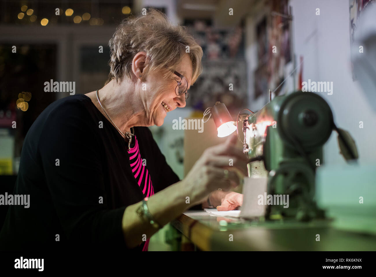 08 February 2019, North Rhine-Westphalia, Köln: EXCLUSIVE - Master tailor Liane Gramsch-Rudolph is working on a tailor-made uniform in her studio. As Guest of Honour of the Traditional Corps, North Rhine-Westphalia's Interior Minister Reul will ride on the Red Spark wagon of the Cologne Shrove Monday Train. (to dpa 'Celebrities let their pants down with her - Cologne's carnival tailor' from 10.02.2019) Photo: Rolf Vennenbernd/dpa - Stock Image