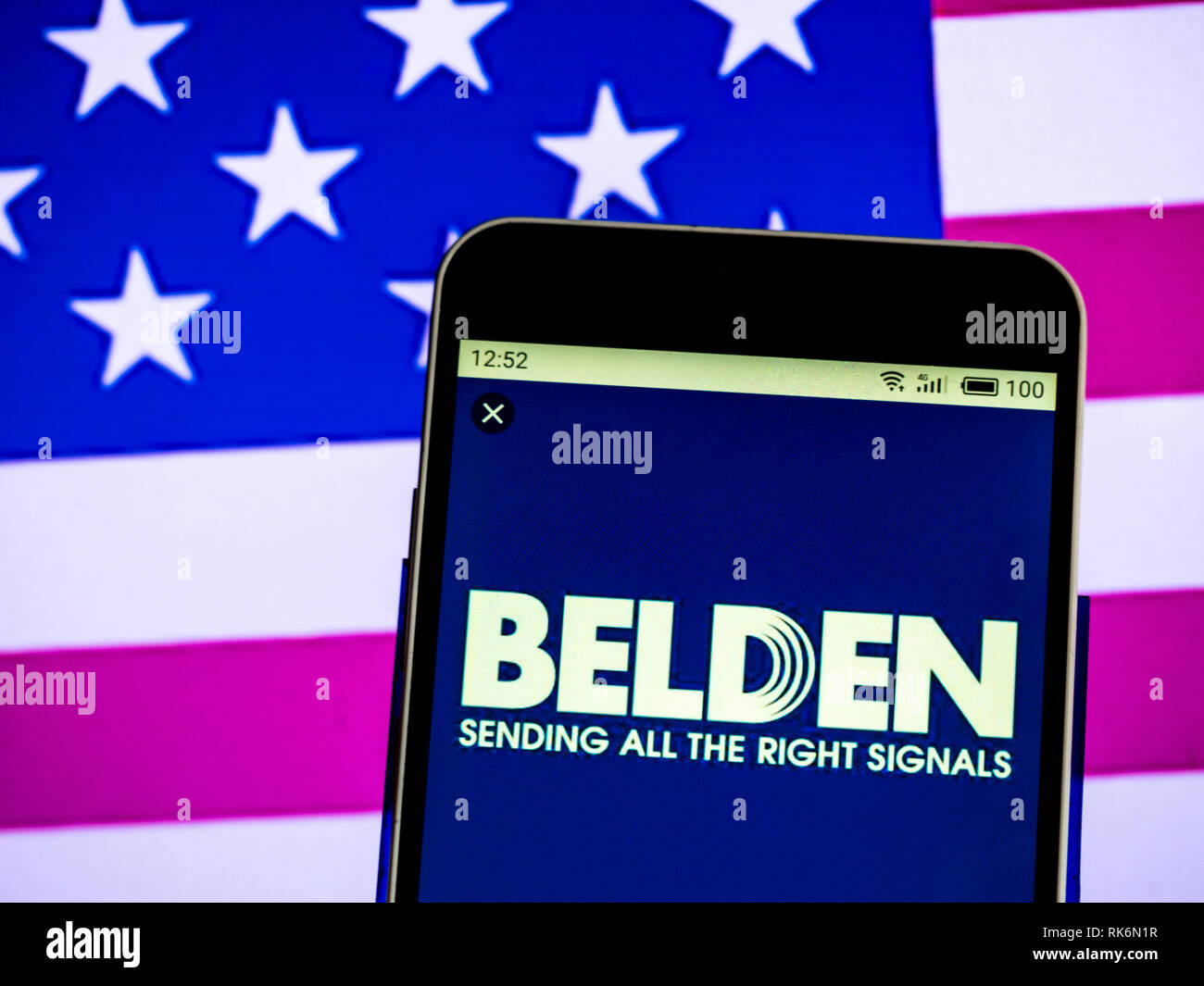 Belden Company logo seen displayed on a smart phone Stock