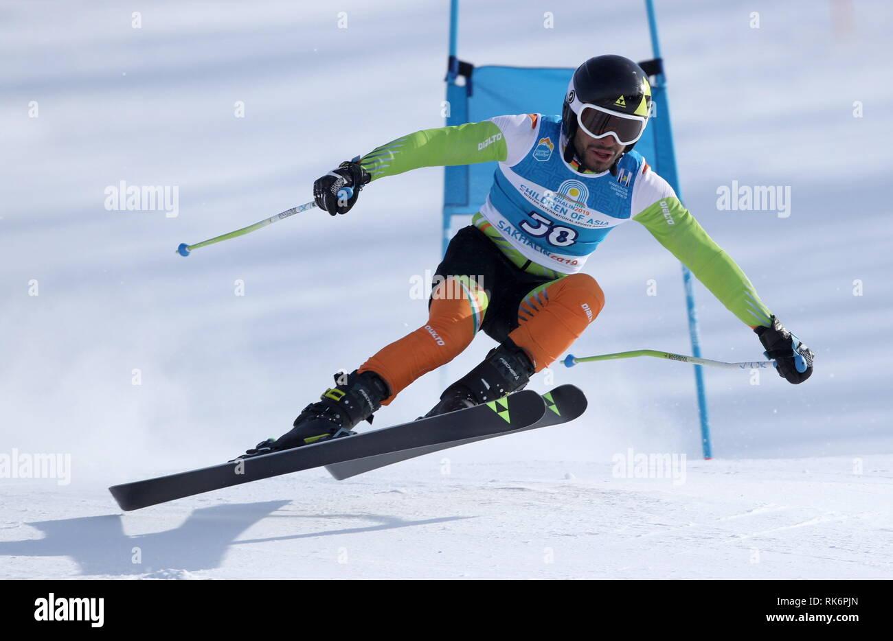 Yuzhno Sakhalinsk, Russia. 10th Feb, 2019. YUZHNO-SAKHALINSK, RUSSIA - FEBRUARY 10, 2019: India's Shaib Malik competes in the alpine skiing men's super giant slalom event at the 1st Children of Asia Winter International Sports Games. Andrei Golovanov/TASS Credit: ITAR-TASS News Agency/Alamy Live News - Stock Image