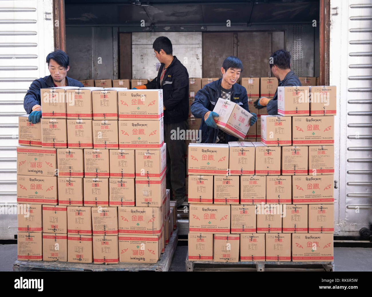 Guangzhou, China's Tibet Autonomous Region. 27th Jan, 2019. Workers unload boxes of butter from the 7220190 refrigerator train at the Lhasa West Railway Station in Lhasa, capital of southwest China's Tibet Autonomous Region, Jan. 27, 2019. Credit: Wu Tao/Xinhua/Alamy Live News - Stock Image