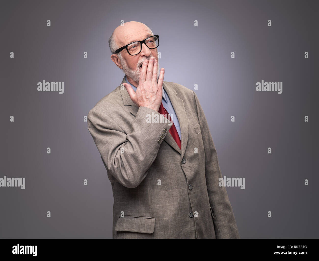 Portrait of senior caucasian yawning man . He is exhausted and tired - Stock Image