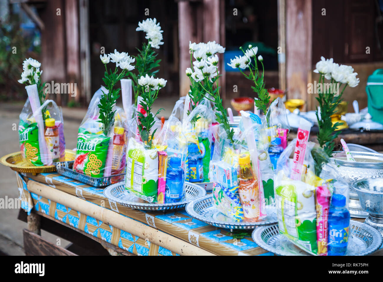 Kanchanaburi, Thailand - December 30, 2018: Alms prepared for Almsgiving (food offerings) to Buddhist monks going on daily alms round in the morning a Stock Photo