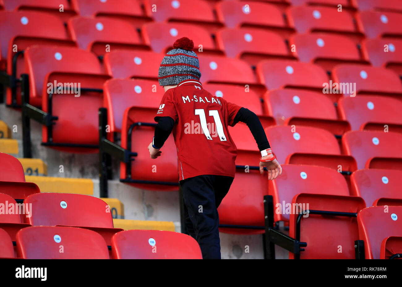 sale retailer cc867 cf9d7 A young Liverpool fan in the stands wearing a Mohamed Salah ...