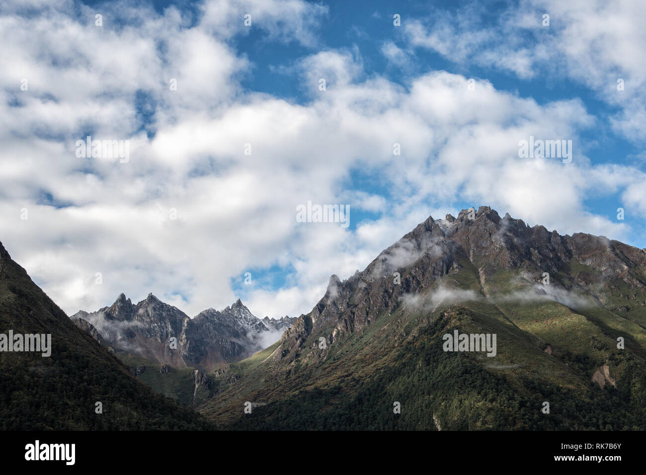 Clouds and mountains from Laya, Gasa District, Snowman Trek, Bhutan - Stock Image