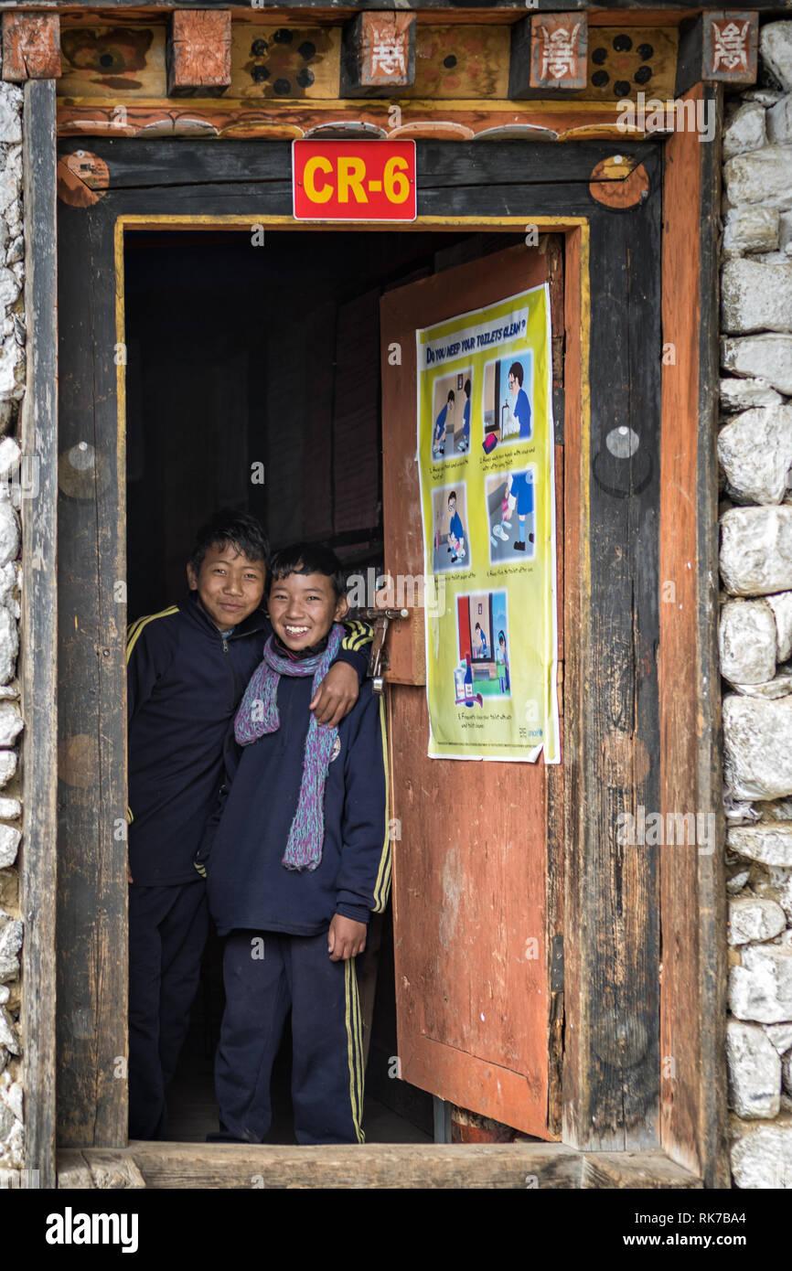 Two happy boys at the door of a class at Laya school, Gasa District, Snowman Trek, Bhutan Stock Photo