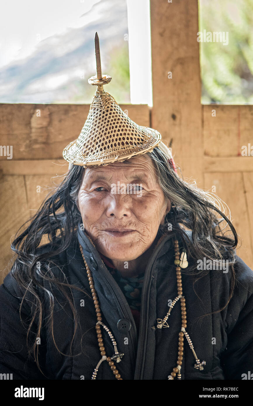 Old Layap woman with her traditional conical hat in Laya, Gasa District, Snowman Trek, Bhutan Stock Photo