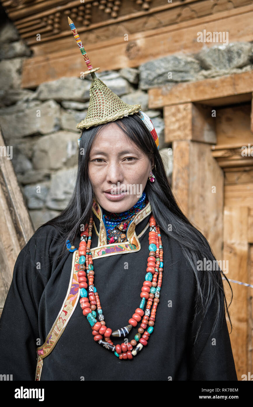 Layap woman in traditional dress in front of her house in Laya, Gasa District, Snowman Trek, Bhutan Stock Photo