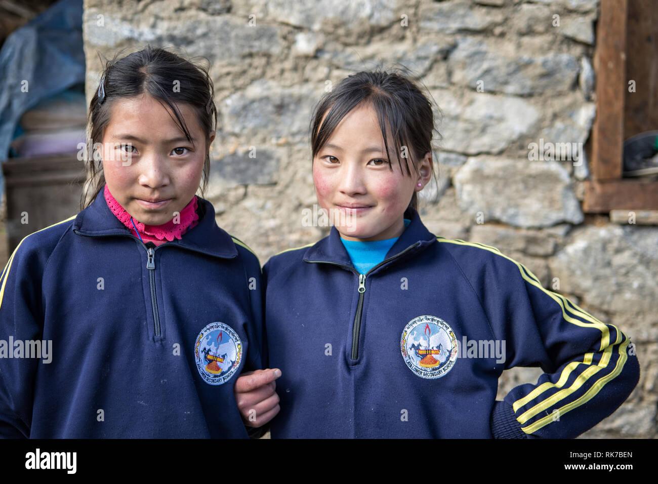 Young schoolgirls in the village of Laya, Gasa District, Snowman Trek, Bhutan Stock Photo
