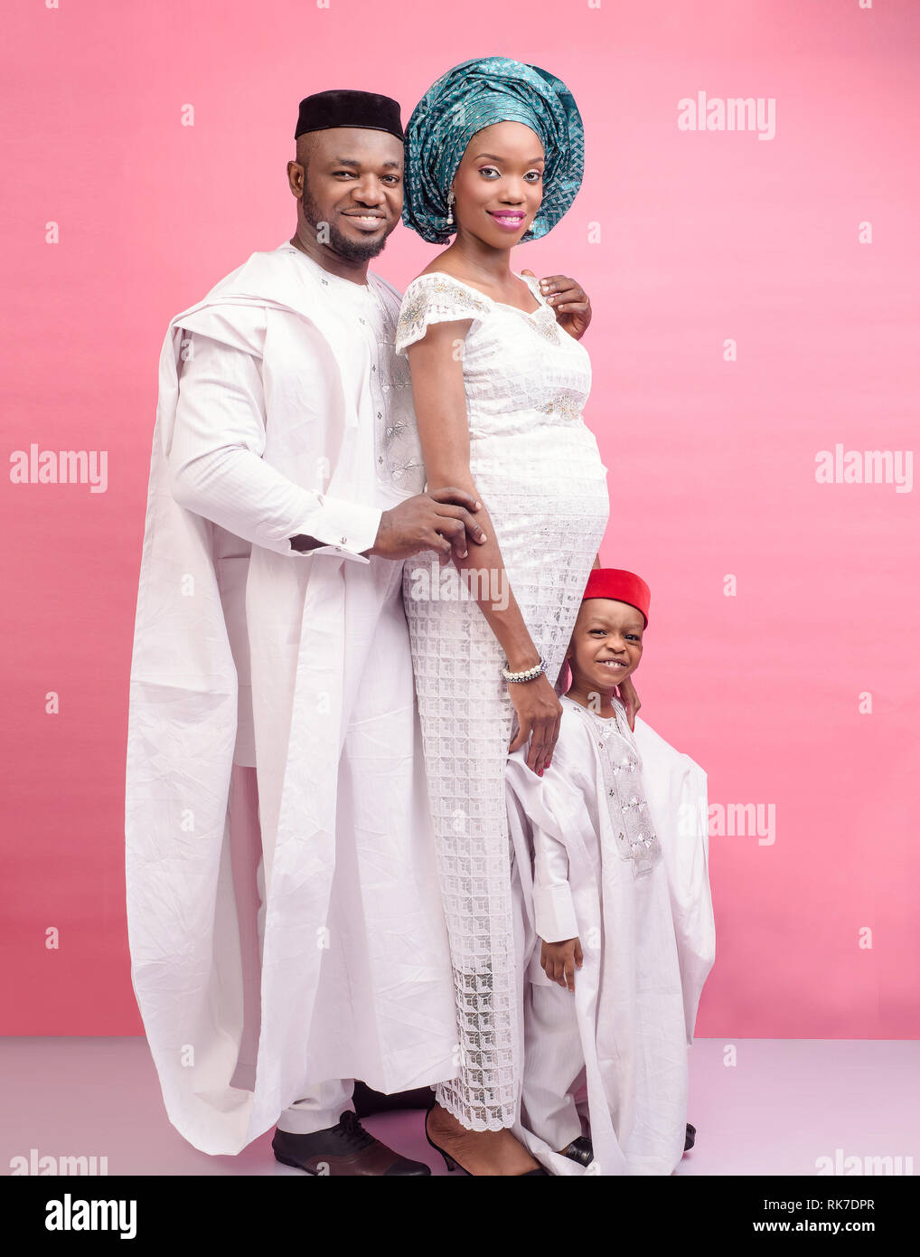 Happy Nigerian father, mother and son dressed in all white traditional attire - Stock Image