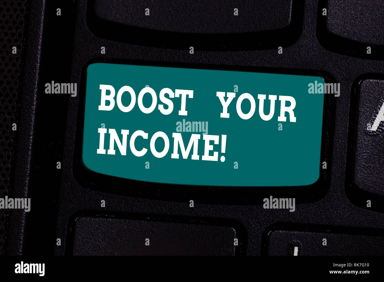 Handwriting text writing Boost Your Income. Concept meaning increase month or annual salary using part time job Keyboard key Intention to create compu - Stock Image