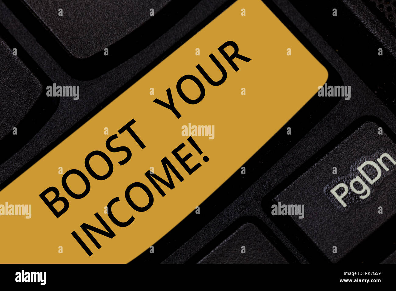 Word writing text Boost Your Income. Business concept for increase month or annual salary using part time job Keyboard key Intention to create compute - Stock Image