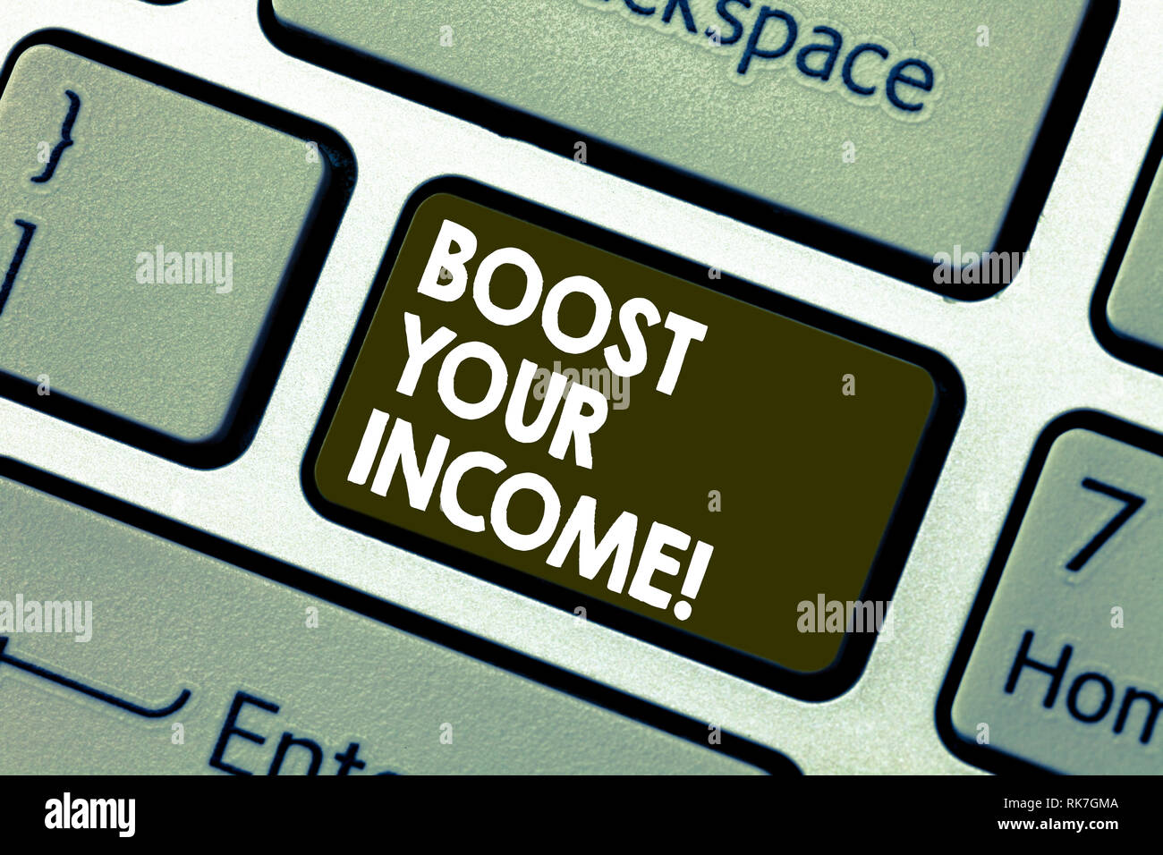 Writing note showing Boost Your Income. Business photo showcasing increase month or annual salary using part time job Keyboard key Intention to create - Stock Image