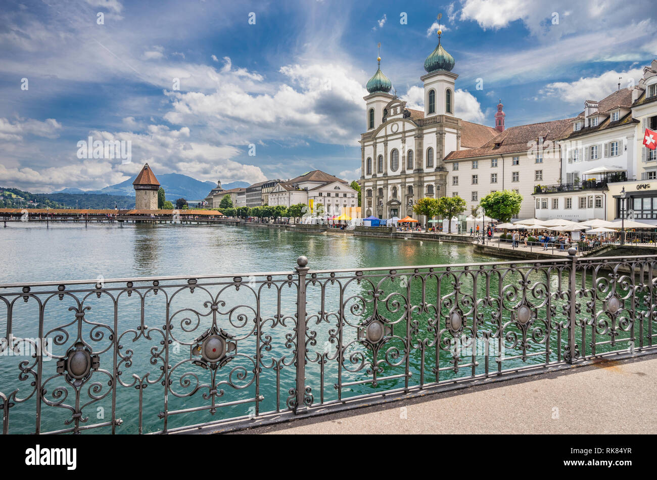 river Reuss with view of Lucerne Jesuit Church and the iconic Kapellbrücke (Chapel Bridge), Lucerne, Canton Lucerne, Switzerland - Stock Image