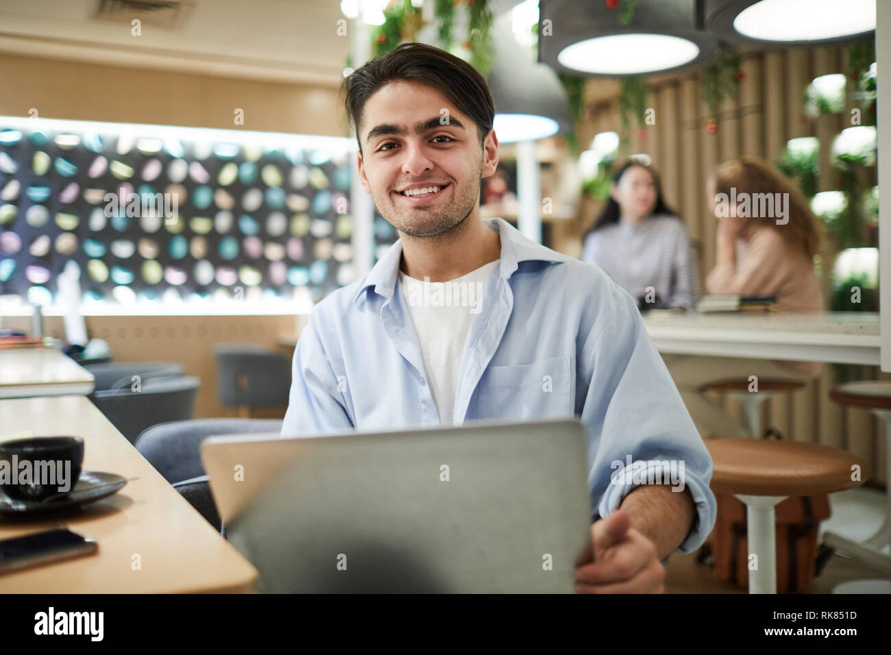 Student with laptop - Stock Image